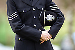 © Joel Goodman - 07973 332324 . 17/03/2012 . Staffordshire , UK . A police officer in dress uniform stands alone outside the crematorium , listening to the service as it is relayed on loudspeaker . The funeral of former police officer David Rathband , at Stafford Crematorium . Rathband was found dead at his home in Blyth on 29th February 2012 . He was shot and blinded by killer Raoul Moat whilst he was on duty in the early hours of 4th July 2010 and went on to campaign for the Blue Lamp Foundation , which supports emergency staff injured in the line of duty , but he was reported to have never overcome the psychological impact of his injuries . Photo credit : Joel Goodman