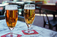 Chablis; two cool beers at 42 degrees hot summer day at a bar in the village, Bourgogne