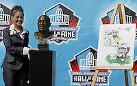 Sara White, wife of hall of fame inductee Reggie White, poses with Reggie's bust during the Pro Football Hall of Fame induction ceremony Saturday, Aug. 5, 2006, in Canton, Ohio.<br />
