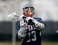 Rob McMullen (23) looks to pass the ball while playing Maryland at Ludwig Field in College Park, Maryland.
