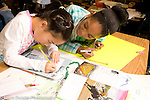 Elementary School Grade 3 geography girls working on map project
