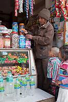 India, Rishikesh.  Children Watching Candy Selection in Neighborhood Shop.