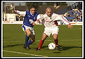 14/9/02       Copyright Pic : James Stewart                     .File Name : stewart-qots v inverness 05.ERIC PATON IS HELD OFF THE BALL BY STUART GOLABEK....James Stewart Photo Agency, 19 Carronlea Drive, Falkirk. FK2 8DN      Vat Reg No. 607 6932 25.Office : +44 (0)1324 570906     .Mobile : + 44 (0)7721 416997.Fax     :  +44 (0)1324 570906.E-mail : jim@jspa.co.uk.If you require further information then contact Jim Stewart on any of the numbers above.........