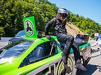 Jun 16, 2018; Bristol, TN, USA; NHRA funny car driver Jonnie Lindberg climbs from his car during qualifying for the Thunder Valley Nationals at Bristol Dragway. Mandatory Credit: Mark J. Rebilas-USA TODAY Sports