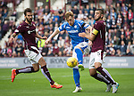 Hearts v St Johnstone...02.08.15   SPFL Tynecastle, Edinburgh<br /> Liam Craig is closed down by Alim Ozturk<br /> Picture by Graeme Hart.<br /> Copyright Perthshire Picture Agency<br /> Tel: 01738 623350  Mobile: 07990 594431