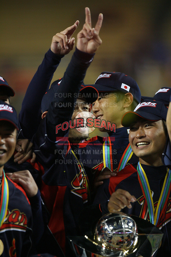 Ichiro Suzuki and Norichika Aoki of Japan celebrate their victory over Korea at the World Baseball Classic at Dodger Stadium on March 23, 2009 in Los Angeles, California. (Larry Goren/Four Seam Images)