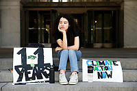 Leandra Mira, 17, protesting for climate change on the steps of the city county building, poses for a portrait on Friday June 21, 2019 in Pittsburgh, Pennsylvania. (Photo by Jared Wickerham/Pittsburgh City Paper)