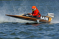 Frame 1: Bruce Hansen (44-W) blows over in a turn then turns upright after landing.....Stock  Outboard Winter Nationals, Ocoee, Florida, USA.13/14 March, 2010 © F.Peirce Williams 2010