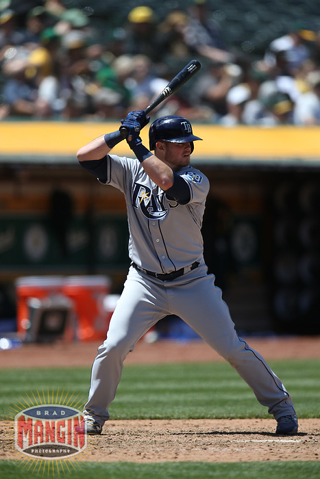 OAKLAND, CA - MAY 31:  Christian Arroyo #21 of the Tampa Bay Rays bats against the Oakland Athletics during the game at the Oakland Coliseum on Thursday, May 31, 2018 in Oakland, California. (Photo by Brad Mangin)