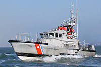 A 47 foot Motor Lifeboat based at Station Golden Gate patrols the waters of San Francisco Bay during 2006 San Franciso Fleet Week Activities. Station Golden Gate operates 3 of the 47 foot MLB's and is responsible for the coastal and offshore water near the San Francisco Bay Area. The MLB is built to withstand the most severe conditions at sea and are self-bailing, self-righting, and almost unsinkable. Photographed 10/08/06