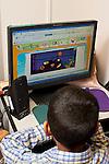 Education Preschool 4 year olds boy using computer in classroom