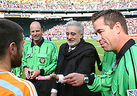 Placido Domingo shows the result of the coin toss to Houston captain Wade Barrett. The Houston Dynamo defeated the New England Revolution 2-1 in the finals of the MLS Cup at RFK Memorial Stadium in Washington, D. C., on November 18, 2007.