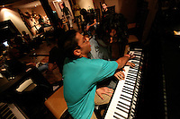 The only place where Iranaians can play their music to  audience is at private parties. Musicians what instruments or other objects they can find and make improvised jam sessions. Since the revolution of 1978, Iran has been living under strict Islamic rule. One law that has been enforced on iranian is banning the preformance of western music in public. Jazz, rock, hip hop, heavy metal and more have been deemed forbidden by the government. Despite threats od imprisonment, whipping and other punisments, Tehran youth defy the ban and continue to create music in underground studios. Some who are good enough are signed up by record companies overseas and eventually leave Iran for more prosperous oppportunities in the West. But some are ademant about staying in Iran and trying to build a music scene under the increasingly difficult condtions.
