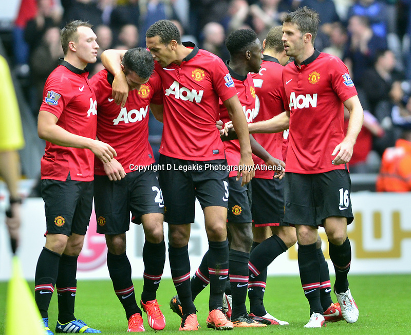 Manchester united celebrating their third goal, scored by Robin Van Persie.<br /> Saturday 17 August 2013<br /> Pictured: <br /> Re: Barclays Premier League Swansea City v Manchester United at the Liberty Stadium, Swansea, Wales