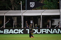 LAKE BUENA VISTA, FL - JULY 16: Jonathan Mensah #4 of the Columbus Crew SC before the game during a game between New York Red Bulls and Columbus Crew at Wide World of Sports on July 16, 2020 in Lake Buena Vista, Florida.