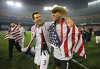 Carlos Bocanegra and Tim Howard celebrate.after a 2-2 tie with Costa Rica to put the USA in first place of CONCACAF 2010 World Cup qualifying, at RFK Stadium, in Washington DC, Wednesday, October 14, 2009.