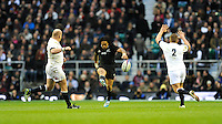 Ma'a Nonu of New Zealand chips ahead during the QBE Autumn International match between England and New Zealand at Twickenham on Saturday 16th November 2013 (Photo by Rob Munro)