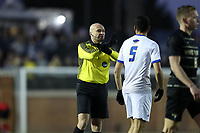 WINSTON-SALEM, NC - DECEMBER 07: Referee Robert Sibiga warns a player during a game between UC Santa Barbara and Wake Forest at W. Dennie Spry Stadium on December 07, 2019 in Winston-Salem, North Carolina.