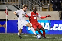 Notre Dame Fighting Irish forward Vince Cicciarelli (21) and New Mexico Lobos midfielder Michael Kafari (10). The Notre Dame Fighting Irish defeated the New Mexico Lobos 2-0 during the semifinals of the 2013 NCAA division 1 men's soccer College Cup at PPL Park in Chester, PA, on December 13, 2013.