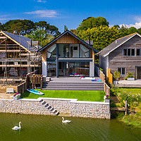 BNPS.co.uk (01202 558833)<br /> Pic: ShorePartnership/BNPS<br /> <br /> Pictured: The house, garden and steps to the water.<br /> <br /> A brand new waterfront home perfect for paddleboarders is on the market for £1.3m.<br /> <br /> Creek View is built on a former boatyard and has direct water access to Restronguet Creek from steps in the back garden.<br /> <br /> The contemporary four-bedroom house has an open-plan living space and floor-to-ceiling glass overlooking the water to make the most of its stunning location.