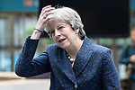 © Joel Goodman - 07973 332324 . 02/10/2017. Manchester, UK. Prime Minister THERESA MAY straightens her hair as she enters the conference hall from the wind , at the start of the second day of the Conservative Party Conference at the Manchester Central Convention Centre . Photo credit : Joel Goodman