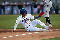Lency Delgado (5) of the Kannapolis Cannon Ballers slides into third base during the game against the Fayetteville Woodpeckers at Atrium Health Ballpark on June 22, 2021 in Kannapolis, North Carolina. (Brian Westerholt/Four Seam Images)
