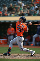 OAKLAND, CA - SEPTEMBER 25:  Kyle Tucker #30 of the Houston Astros bats against the Oakland Athletics during the game at the Oakland Coliseum on Saturday, September 25, 2021 in Oakland, California. (Photo by Brad Mangin)