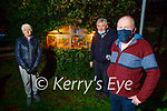 Georgie Lynch a frontline worker at UHK lit the Crib in Manor Estate on Tuesday night. Georgie Lynch (front) with Freda Conroy and Joe Moynihan