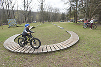 TEST AT THE FEST<br />A young rider pedals along the skills course Saturday April 3 2021 at the 32nd annual Ozark Mountain Bike Festival at Devil's Den State Park. The festival  featured guided group mountain bike rides for beginner and experienced riders, instructional rides to improve riding technique, bike limbo and big splash contest. Riders were also allowed pedal over some of the new trails in the park that will not officially open for about a month. Go to nwaonline.com/210404Daily/ to see more photos.<br />(NWA Democrat-Gazette/Flip Putthoff)