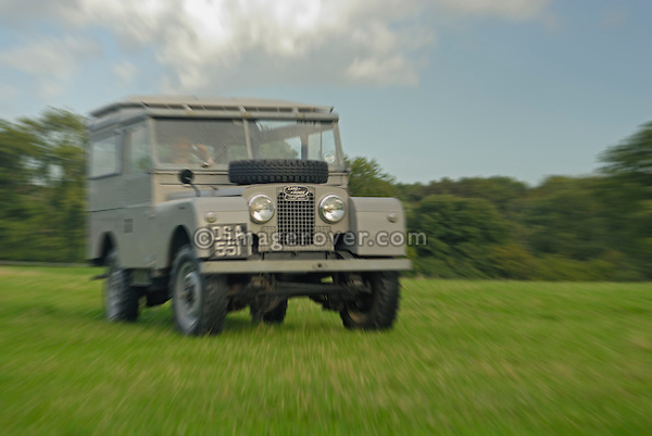 Very original historic 1950's Landrover Series 1 88in Station Wagon of the Dunsfold Collection driven by Philipp Bashall across a field in Dunsfold, Surrey, south England. Europe, UK, England, Surrey, Dunsfold. --- No releases available. Automotive trademarks are the property of the trademark holder, authorization may be needed for some uses.