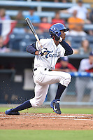 Asheville Tourists left fielder Raimel Tapia #15 swings at a pitch during a game against the Hagerstown Sun at McCormick Field on September 8, 2014 in Asheville, North Carolina. The Tourists defeated the Suns 16-7. (Tony Farlow/Four Seam Images)