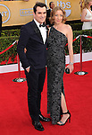 Ty Burrell, Holly Burrell attends The 20th SAG Awards held at The Shrine Auditorium in Los Angeles, California on January 18,2014                                                                               © 2014 Hollywood Press Agency