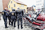 Motorcycles and riders dressed in leather in town sqaure