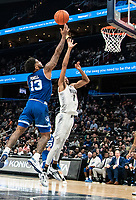 WASHINGTON, DC - FEBRUARY 05: Myles Powell #13 of Seton Hall fires in a shot over Jamorko Pickett #1 of Georgetown during a game between Seton Hall and Georgetown at Capital One Arena on February 05, 2020 in Washington, DC.