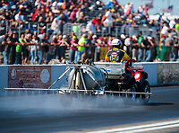 Sep 23, 2018; Madison, IL, USA; NHRA safety safari official sprays traction compound on the track during the Midwest Nationals at Gateway Motorsports Park. Mandatory Credit: Mark J. Rebilas-USA TODAY Sports