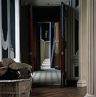 A view from the columned dining room across the marble-floored entrance hall along a grand corridor