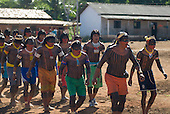 Pará State, Brazil. Aldeia Kokraimoro (Kayapo). Warriors dancing, Cacique Mudjico at the front.