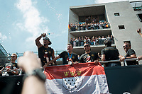 Berlin, 15.07.2014. Die Ankunft der Deutschen Fussballnationalmannschaft in Berlin.<br /> <br /> English: Berlin Welcomes the World champions, German soccer national team wins FiFA World Cup in Brazil, welcome party in Berlin, Germany, June 15, 2014. Arrival of the champions on an open truck, Lukas Podolski with flag of Cologne