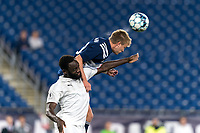 FOXBOROUGH, MA - SEPTEMBER 1: Tobenna Uzo #7 of FC Tucson and Sean O'Hearn #40 of New England Revolution II battle for head ball during a game between FC Tucson and New England Revolution II at Gillette Stadium on September 1, 2021 in Foxborough, Massachusetts.