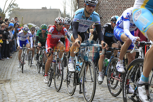 The peloton including Tom Boonen (BEL) Omega Pharma-Quickstep climbs Molenberg during the 96th edition of The Tour of Flanders 2012, running 256.9km from Bruges to Oudenaarde, Belgium. 1st April 2012. <br /> (Photo by Eoin Clarke/NEWSFILE).