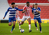 6th February 2021; Bet365 Stadium, Stoke, Staffordshire, England; English Football League Championship Football, Stoke City versus Reading; John Obi Mikel of Stoke City is shut down by Andy Rinomhota and Josh Laurent of Reading