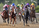 Flashpoint (#4), Cornelio Velasquez up, leads the field heading into the first turn, with Shackleford (#5), Jesus Lopez Castanon up, right behind him in the136th running of the Preakness Stakes at Pimlico Race Course, May 21, 2011. (Joan Fairman Kanes/Eclipsesportswire)