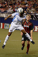 The  Wizard's Jose Burciaga Jr. heads the ball as the  MetroStars' John Wolyniec watches. The Kansas City Wizards were defeated by  the NY/NJ MetroStars to a 1 to 0 at Giant's Stadium, East Rutherford, NJ, on May 30, 2004.
