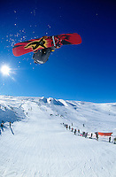 A snowboarder in action during competition.