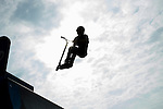 CHESHIRE, CT-6 July 2015-070615EC02-  Connor Ingman practices a trick, called a deck grab, on his scooter at Cheshire's Bartlem Park Monday afternoon. Ingman, 17, is sponsored by Proteus Clothing company and is hoping to go professional one day. Erin Covey Republican-American