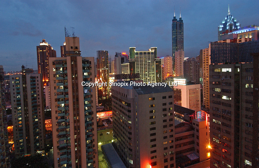 Shenzhen city in south China. Shenzhen was the first city to experience the economic miracle that has overtaken the China and the city where Deng Xioaping's experiment with market reforms where first introduced. it has changed from a sleepy village of several thousand in 1970 to one of around 10 million today..