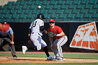 Mississippi Braves first baseman Ryan Casteel (26) waits for a pickoff attempt throw as Jeffrey Baez (33) gets back to the bag during a Southern League game against the Jackson Generals on July 23, 2019 at The Ballpark at Jackson in Jackson, Tennessee.  Jackson defeated Mississippi 2-0 in the first game of a doubleheader.  (Mike Janes/Four Seam Images)