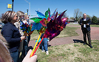 Employees of the Children's Safety Center of Washington County gather while Springdale mayor Doug Sprouse reads a proclamation Thursday April 1, 2021 to kick-off Pinwheels for Prevention for Child Abuse Awareness Month. (NWA Democrat-Gazette/J.T. Wampler)