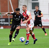 Lincoln City's Liam Bridcutt vies for possession with Fleetwood Town's Ched Evans<br /> <br /> Photographer Chris Vaughan/CameraSport<br /> <br /> The EFL Sky Bet League One - Fleetwood Town v Lincoln City - Saturday 17th October 2020 - Highbury Stadium - Fleetwood<br /> <br /> World Copyright © 2020 CameraSport. All rights reserved. 43 Linden Ave. Countesthorpe. Leicester. England. LE8 5PG - Tel: +44 (0) 116 277 4147 - admin@camerasport.com - www.camerasport.com