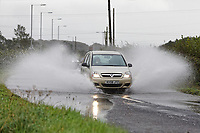 A car drives through a flooded part of Water Street between the areas of Port Talbot and Pyle in south Wales, UK. Sunday 29 September 2019